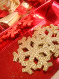 Christmas toys in red box. Holiday background Stock Photos