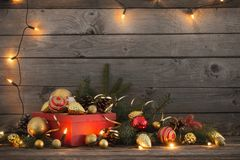 Christmas toys and red box on old wooden background Royalty Free Stock Photo