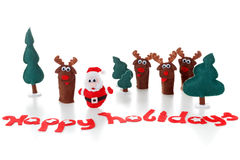 Christmas toys Santa, reindeer in snow for  xmas. Isolated on white concept. Royalty Free Stock Photo