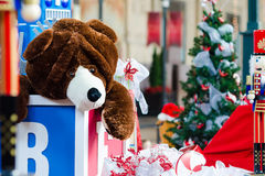 Christmas Toys. Christmas scene with Holiday Decorations, Tree & Toys left by Santa Claus with giant toy block, brown teddy bear, wooden XMAS Nutcracker stock image