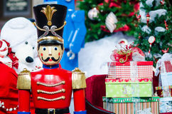 Christmas Toys. Christmas scene with Holiday Decorations, Tree & Toys left by Santa Claus with giant victorian toy nutcracker Stock Image