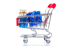 Christmas toys in shopping cart Royalty Free Stock Photo