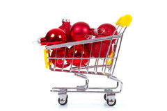 Christmas toys in shopping cart Stock Image