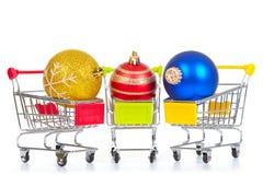 Christmas toys in shopping cart Royalty Free Stock Photos