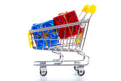 Christmas toys in shopping cart Royalty Free Stock Photography