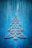 Christmas toys simbol of fir tree on blue background Royalty Free Stock Images