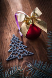 Christmas toys simbol of fir tree and branches on wooden board Royalty Free Stock Photography