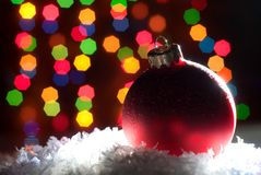 Christmas toys in the snow with a Christmas tree with garlands o Royalty Free Stock Photography
