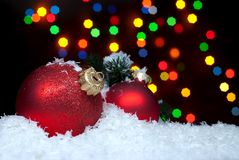 Christmas toys in the snow with a Christmas tree with garlands o Stock Image