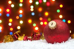 Christmas toys in the snow with a Christmas tree with garlands o Royalty Free Stock Photos