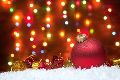 Christmas toys in the snow with a Christmas tree with garlands o Stock Photography