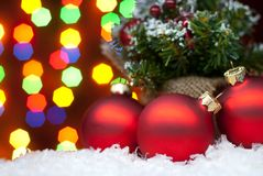 Christmas toys in the snow with a Christmas tree with garlands o Stock Photos