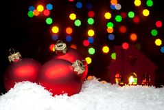 Christmas toys in the snow with a Christmas tree with garlands o Royalty Free Stock Images