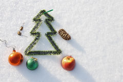 Christmas toys on the snow, lit by the sun in a winter day Royalty Free Stock Images