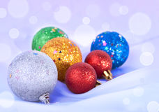 Christmas toys on the snowy background Stock Photo