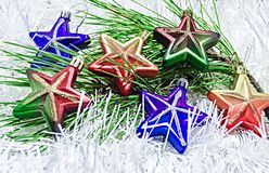 Christmas Toys stars on white decoration with branch of pine tree Stock Image