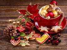 Christmas toys and sweet cookies on wooden table. Top view and selective focus. Happy New Year concept.  stock photography