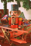 Christmas Toys. A toy soldier nutcracker in front of a Christmas tree Royalty Free Stock Photos