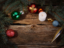 Christmas toys with tree branches burning candle stock images