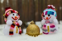 Christmas toys - two snowmen and  golden ball Stock Photography