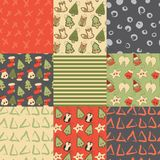 Christmas toys set with cute cartoon seamless patterns. Christmas toys vector hand drawn set with cute cartoon seamless patterns with xmas tree, fox, glove,wings Stock Photos