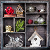 Christmas toys in a vintage wooden box: antique clocks, birdhouse, balls, ribbons and sleigh Santa House Royalty Free Stock Photography