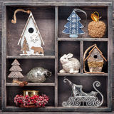 Christmas toys in vintage wooden box. Collage Christmas decorations Royalty Free Stock Photo