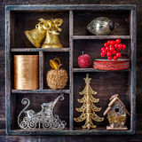 Christmas toys in a vintage wooden tray Royalty Free Stock Images
