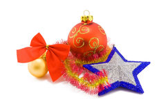 Christmas toys on white. Two christmas balls of red and yellow colors and a silver star with blue edges on white Stock Photo
