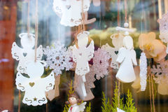 Christmas toys white angels. In the shop window Royalty Free Stock Photos