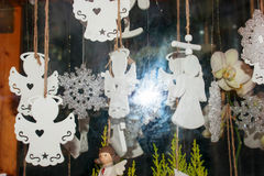 Christmas toys white angels. In the shop window Royalty Free Stock Photography