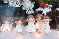 Christmas toys white angels. In the shop window Stock Photos