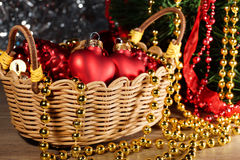 Christmas toys in a wicker basket Royalty Free Stock Photos