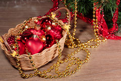 Christmas toys in a wicker basket Stock Photography