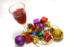 Christmas toys and wine. Golden christmas toys with burn alighte candle Royalty Free Stock Photos