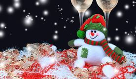 Christmas toys, wine glasses and snowman against in Christmas lights. Christmas toys, wine glasses and snowman against Christmas lights Stock Photos