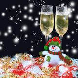 Christmas toys, wine glasses and snowman Stock Photos