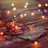 Christmas toys on wooden background Stock Photos