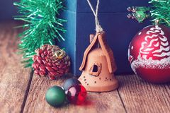 Christmas toys on the wooden texture floor close-up. Balls, toy house, fir cone and chest. Attributes Of Christmas royalty free stock photography
