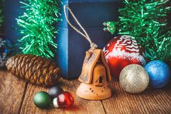 Christmas toys on the wooden texture floor close-up. Balls, toy house, fir cone and chest. Attributes Of Christmas stock photos