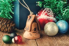 Christmas toys on the wooden texture floor close-up. Balls, toy house, fir cone and chest. Attributes Of Christmas royalty free stock images