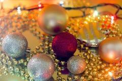 Christmas toys on a yellow garland selective focus bokeh Stock Photography