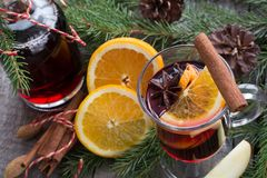 Christmas tradition drink. Hot Mulled wine with cinnamon and christmas tree on board. Close up , copy space. Stock Photo