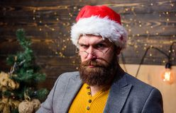 Christmas tradition. Santa claus attributes concept. Serious man beard mustache playing santa role. Man bearded mature. Guy serious face wear santa hat with fur stock image
