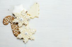CHRISTMAS TRADITIONAL COOKIES WHITE WOOD BACKGROUND - LEFT LAYOUT royalty free stock photo