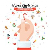 Christmas card with Santa`s hand holding candy cane. Flat design. Christmas traditional decoration elements for greeting card, banners, websites, infographics Royalty Free Stock Photography