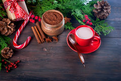 Fir   bumps cones, cocoa in red cup  on the dark wooden backgrou Royalty Free Stock Images