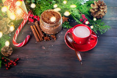 Fir   bumps cones, cocoa in red cup  on the dark wooden backgrou Royalty Free Stock Photos