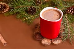 Christmas traditional hot drink cocoa in red cup, fir branches and cones on the dark wooden background copy space Stock Photo