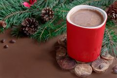 Christmas traditional hot drink cocoa in red cup, fir branches and cones on the dark wooden background copy space Royalty Free Stock Photo